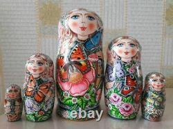 Author's russian matryoshka Butterflies on flowers