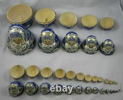 Russian Matryoshka blue and gold stacking dolls signed nest of 19 dolls 20 cm